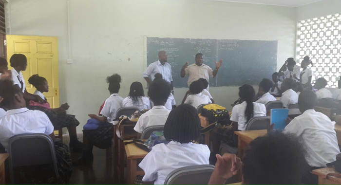 Carlos James, Left, And A School Official Address Students On Tuesday.
