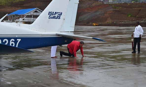 Prime Minister Gonsalves Kisses Ground At Argyle After Disembarking The First Aircraft To Land At The Unfinished Airport In November 2015. (Photo: Sydney K. Morgan/Facebook)