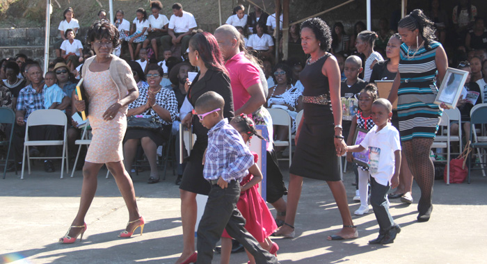 Parents And Relatives Of The Deceased Students At The Memorial Service On Tuesday. Edwards Is Furthest Left.