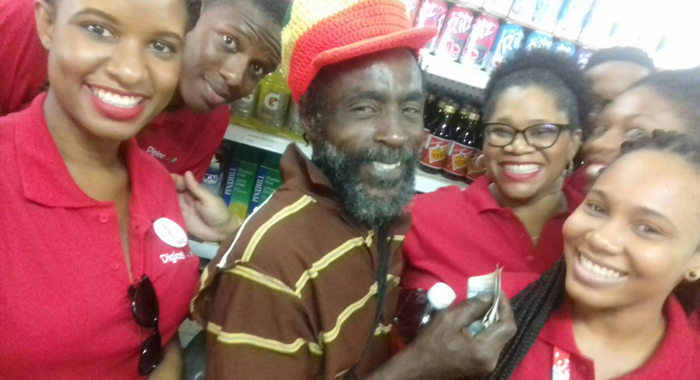 All Smiles As Customers Received Instant Cash To Pay For His Groceries.