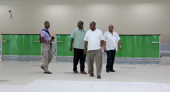 From Left, Beache, Former Minister Of Health, Clayton Burgin, Minister Of National Mobilisation, Frederick Stephenson And Minister Of Tourism Cecil &Quot;Ces&Quot; Mckie, Talk Through The Terminal Building At Argyle International Airport On Friday. (Iwn Photo)