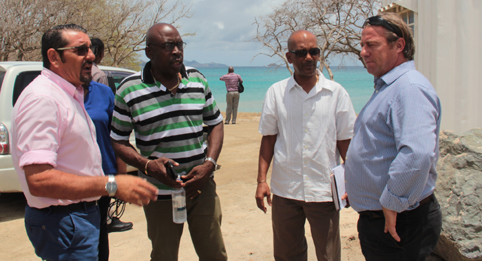 General Manager Of Glossy Bay Construction Company, Roberto Tudisco; Director Of Grenadines Affairs, Edwin Snagg; Permanent Secretary In The Ministry Of National Security, Godfred Pompey; And Marine Construction Project Manager At Glossy Bay Construction Company, Christopher Waddicar, Chat At The Project Site On Friday. (Iwn Photo)