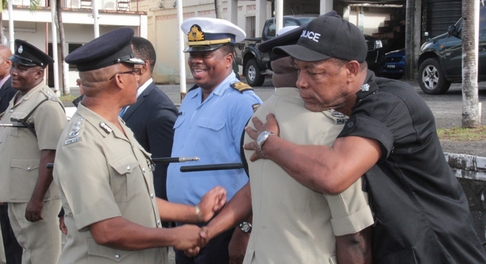 Head Of The Rapid Response Unit, Asp Timothy Hazelwood Embraces Charles At The End Of Thursday'S Parade. (Iwn Photo)