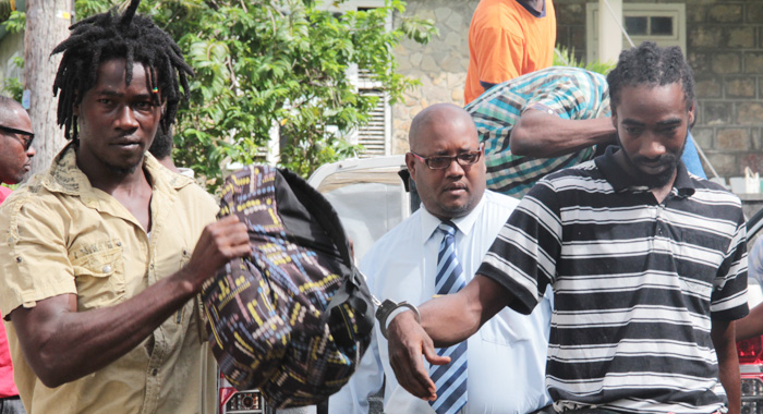 Detective Inspector Atlan Browne, Centre, Escort  Murder Accused Courtney Joseph, Left, And Shemei Joseph To Court On Monday. (Iwn Photo)