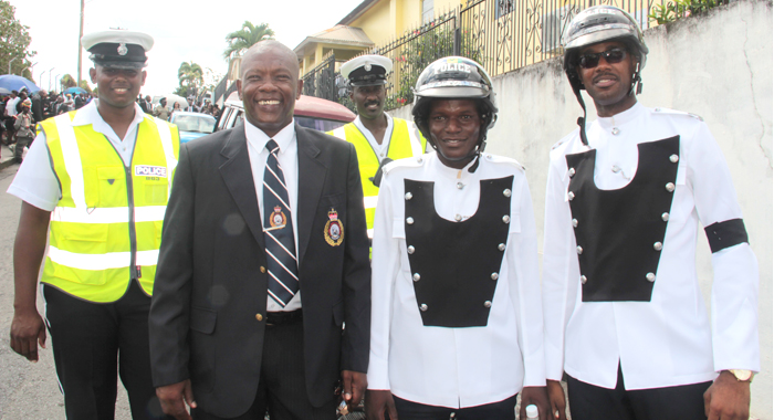 Inspector Calvin Glasgow  Pos With Current Traffic Cops At The Funeral Of Fallen Colleague, Pc Giovanni Charles In Kingstown On May 14, 2016.  (Iwn Photo)