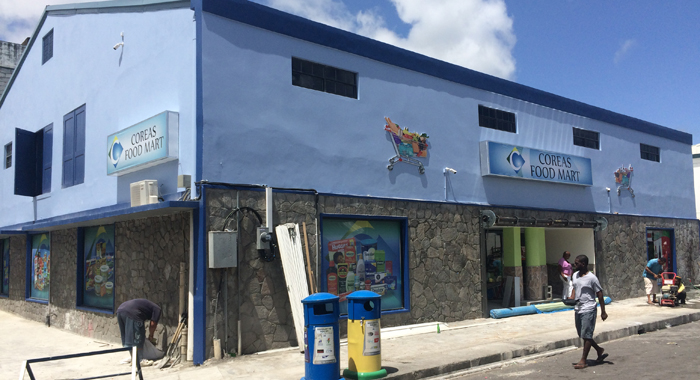 Workers Were On Sunday Putting The Final Touches On The Exterior Of The Refurbished Coreas Food Mart. (Iwn Photo)