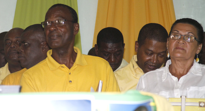 Mp For West Kingstown, Daniel Cummings, Left, Listens To The Speech By Lewis (Not Seen) At Sunday'S Convention. (Iwn Photo)