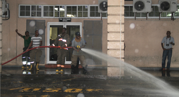 Fire Fighters Were Thursday Afternoon Still Cleaning Up Kingstown After Floods On Wednesday, Even As More Rain Was Forecast For Thursday Night. (Iwn Photo)