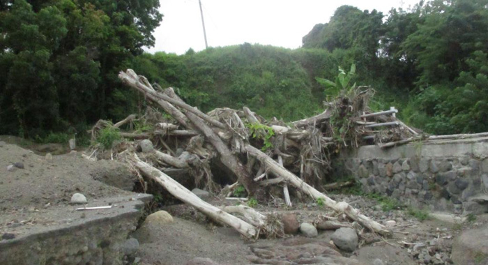 Section Of The Main Road Badly Damaged With A Lot Of Debris The Same As It Was 6 Months Ago
