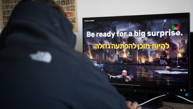 """A man watches a video on an Israeli website hacked by a group calling itself the """"Hacking Saviours"""" in an office in Jerusalem on May 21, 2020. Photo by Yonatan Sindel/Flash90."""