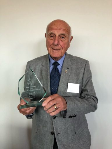 Terry Coffey, company owner, with the MiL award