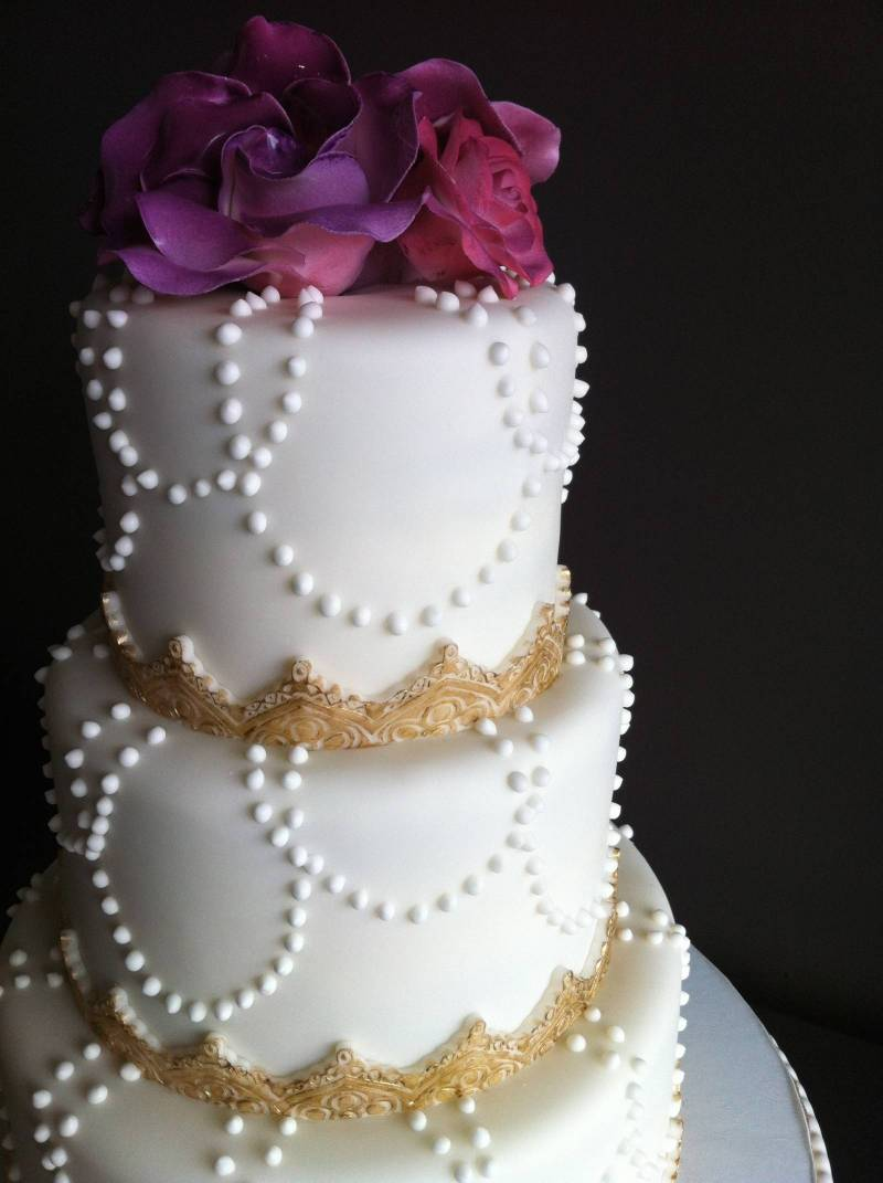 Vintage Wedding Cakes   Canmore Wedding Cake We are absolutely in love with this vintage grey wedding cake encrusted  with jewels and accented with bold black and peach flowers
