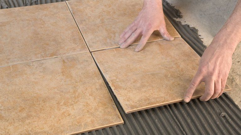 how to use a laser level for laying tiles