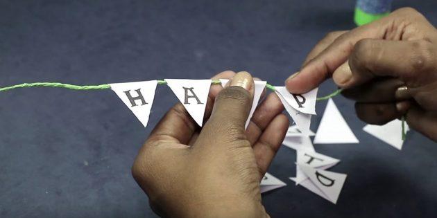 """Schreiben Sie in jedem Dreieck in einem Buchstaben der Phrase """"Alles Gute zum Geburtstag"""""""