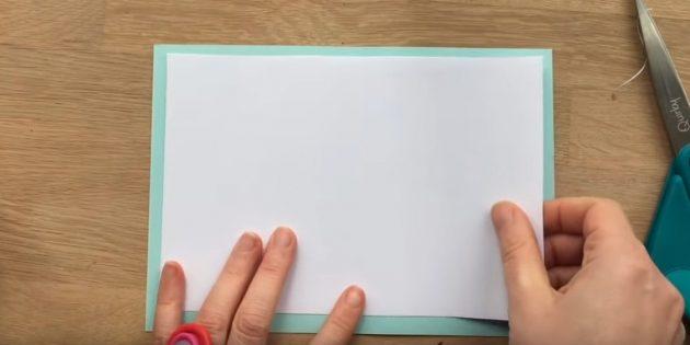 Tagliare i rettangoli da carta bianca e blu