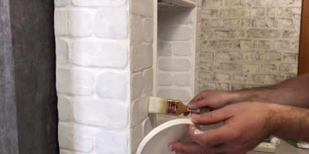 After drying, you paint the fireplace of white acrylic matte paint in several layers