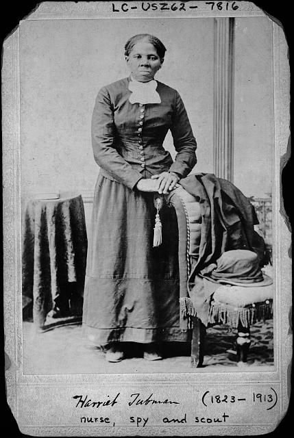 [Harriet Tubman, full-length portrait, standing with hands on back of a chair]