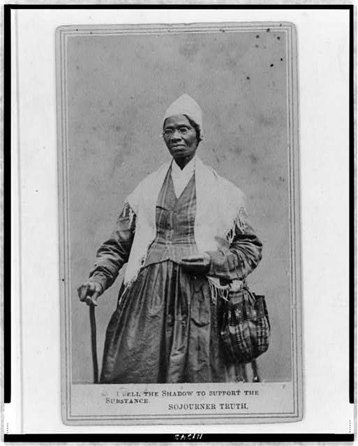 [Sojourner Truth, three-quarter length portrait, standing, wearing spectacles, shawl, and peaked cap, right hand resting on cane]