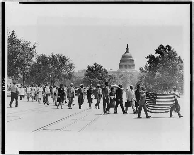 [Group of African-Americans, marching near the Capitol building in Washington, D.C., to protest the lynching of four African-Americans in Georgia]