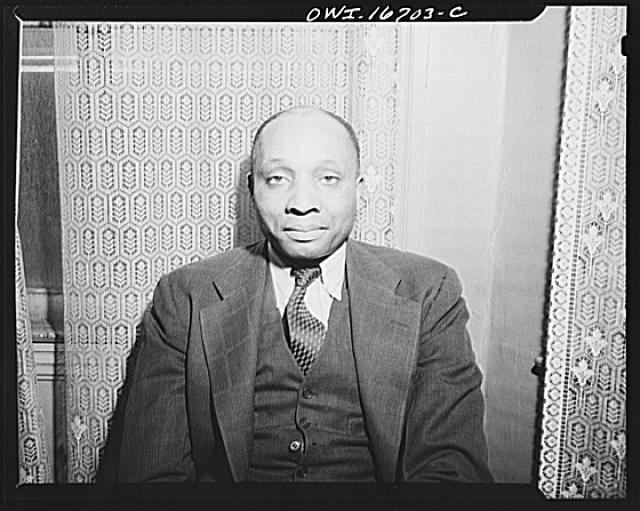 Detroit, Michigan. This man worked at Ford factory but was unable to live in a decent place until Sojourner Truth homes were open for occupancy
