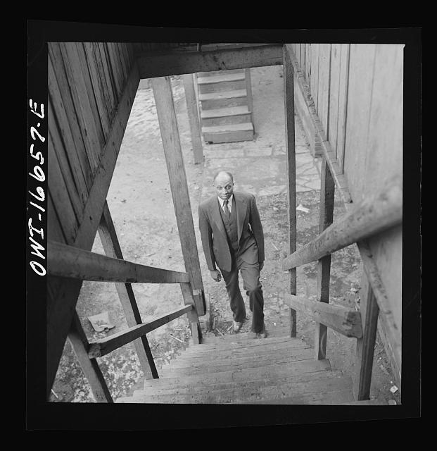 Detroit, Michigan. Coming up the stairway to a Negro's home. These are conditions under which families originally lived before moving to the Sojourner Truth housing project