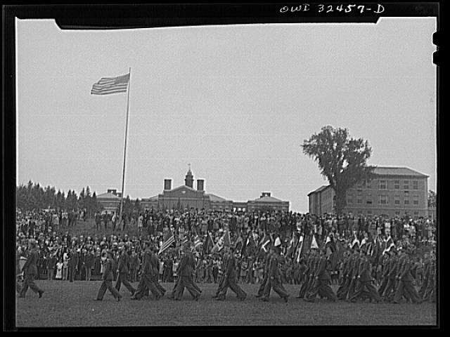 Oswego, New York. Air cadets marching in front of the boy scouts carrying United Nations flags on Flag Day 1943 during United Nations week. Photo by Marjory Collins, Library of Congress image