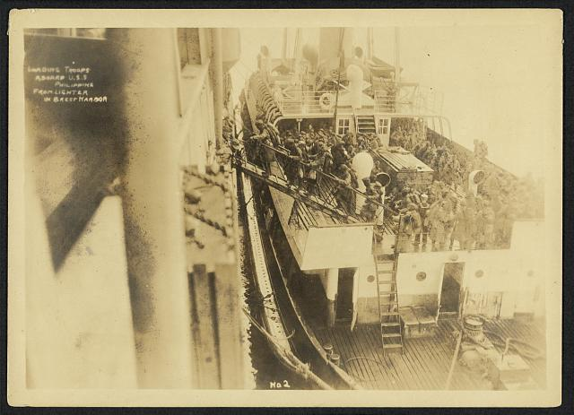 [803rd Pioneer Infantry Battalion on the U.S.S. Philippine (troop ship), from Brest harbor, France, July 18, 1919]. no. 2, Landing troops aboard U.S.S. Philippine from lighter in Brest Harbor