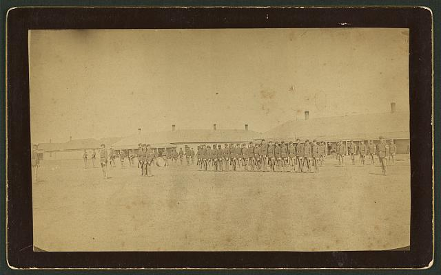 [Integrated guard mount, Ft. Niobrara, Nebraska, composed of 8th regiment and 9th cavalry regiment, same formation with other troops, band on parade]