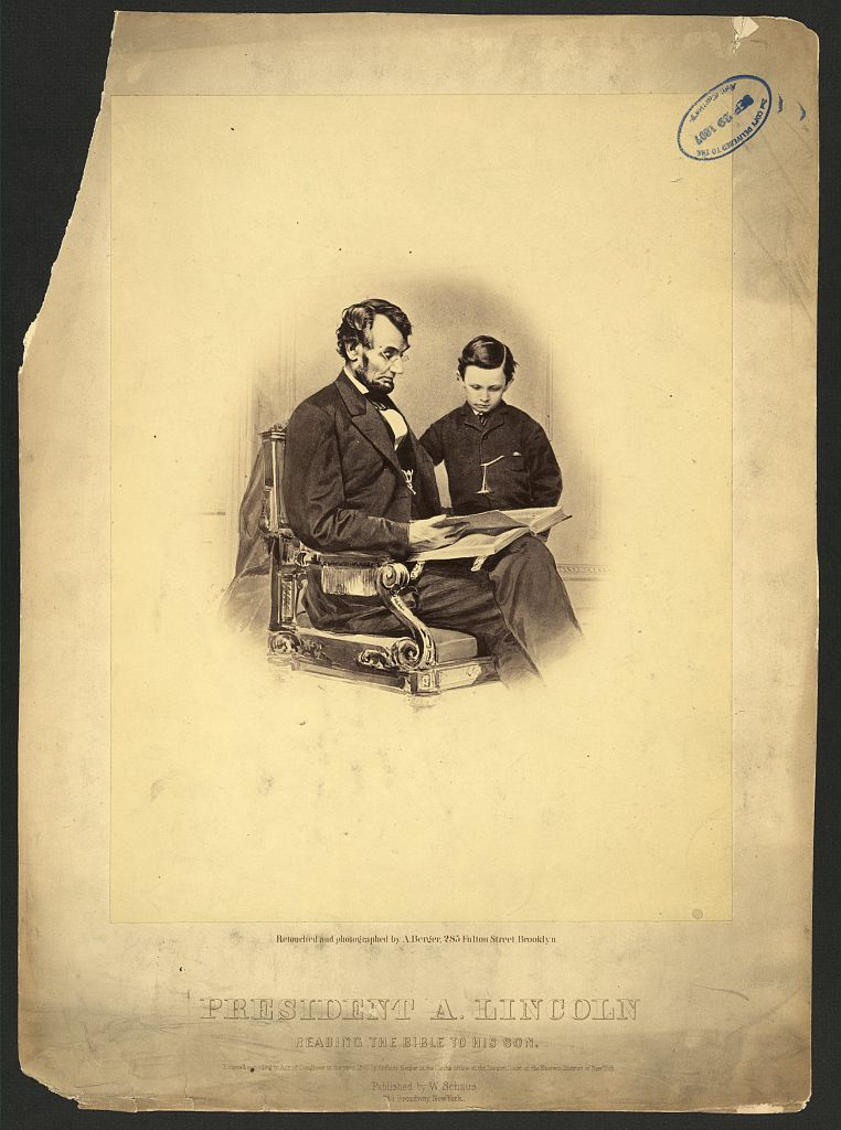Lincoln reading to son, Tad; LOC photo