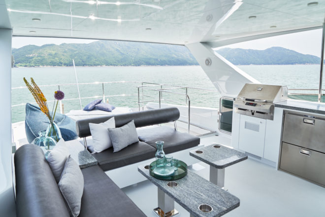 The flybridge has an L-shaped sofa, with an adjustable backrest on the aft seating