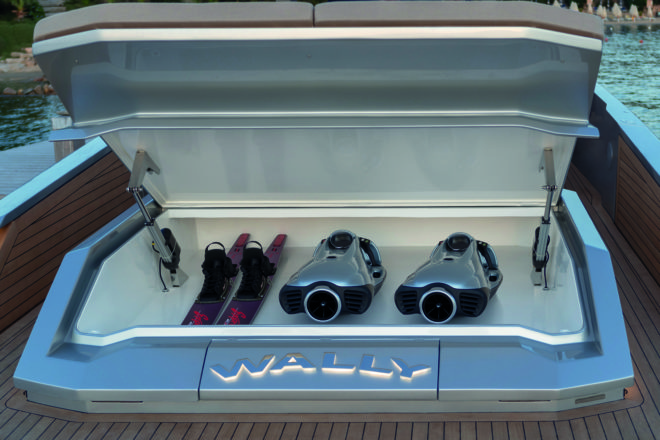 On the 48 Wallytender, the aft double sunpad can be raised to access the toy garage