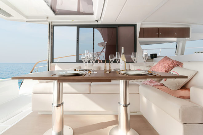 The dining table and main L-shaped sofa are portside, close to the forward galley