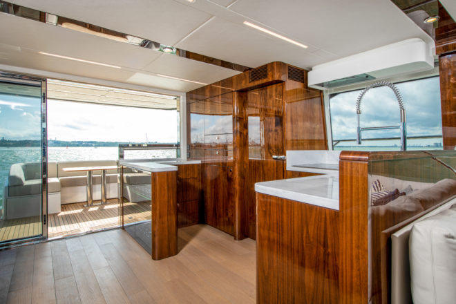 The interior starts with a large, well equipped galley, which includes a useful L-shaped counter