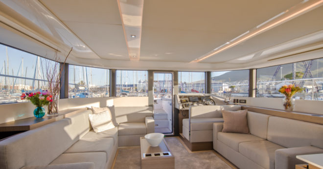 The well-lit saloon features quality joinery and carpeting, the latter one of many options on the first hull in Asia, such as a foldable dining table instead of a coffee table
