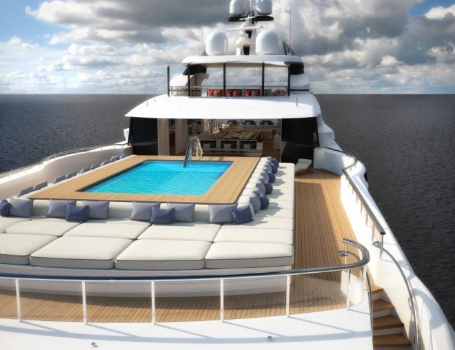 The sun deck features a large pool surrounded by sunpads