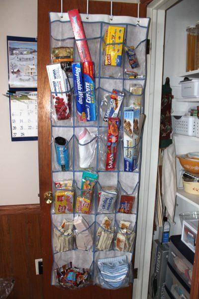 kitchen pantry shoe organizer hangs over the door