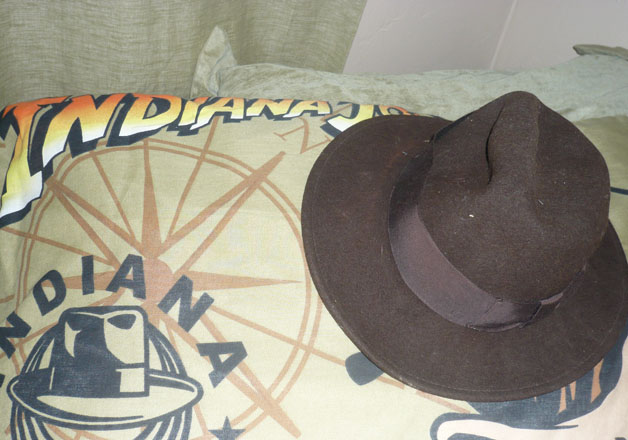 indianajones_hat_on_bedding.jpg