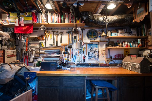 The workbench -- easily cleared when more space is needed.  Wine cellar is to the right,  shop doors and detached garage project downhill to the left.
