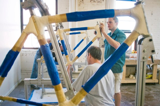 The bamboo way: Bike enthusiasts take weekend workshops at the Bamboo Bike Studio to build their own bikes. Frames are masked with painter's tape and secured in aluminum jigs while the joints are wrapped in carbon fiber soaked in epoxy.