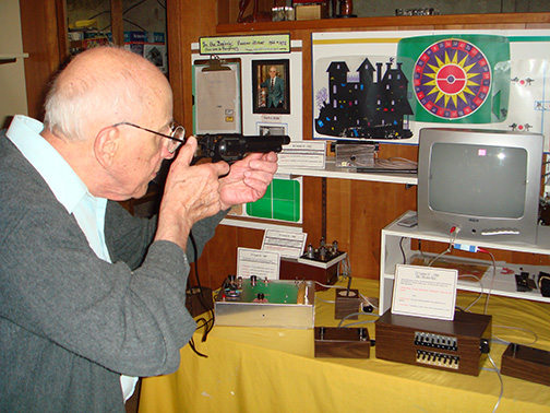 Ralph demonstrating the first-ever light-gun game. He was a expert on military small arms in the U.S. Army during World War II.