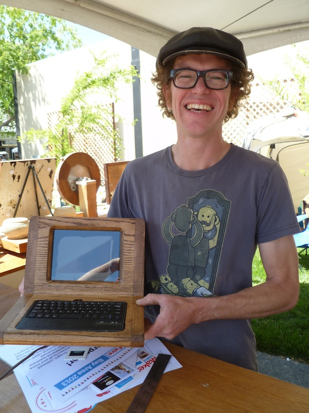 Hudson Cress, carpenter, and his custom IPad Mini enclosure with included photographic slide viewer.
