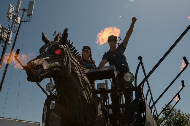 MAKE Senior Editor Goli Mohammadi rides Chester, a fire breathing horse made from used tires.