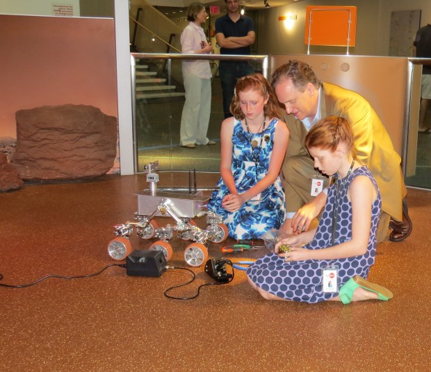 Robert, Camille, and Genevieve Beatty with their rover at NYSCI Photo Credit: Andrew Terranova