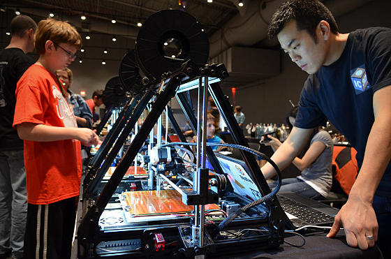 Michael Cao with an IC3D RepRap at the Columbus Mini Maker Faire 2012