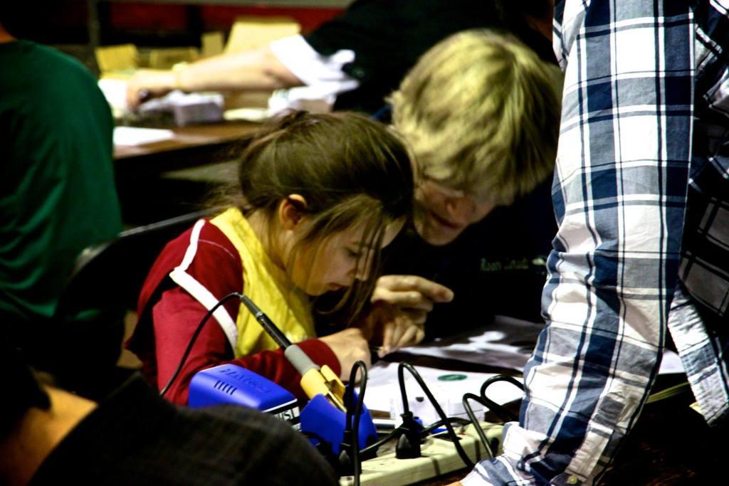 girl soldering