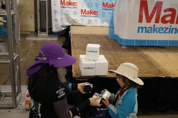 Girls discovering Linkbots at Maker Faire