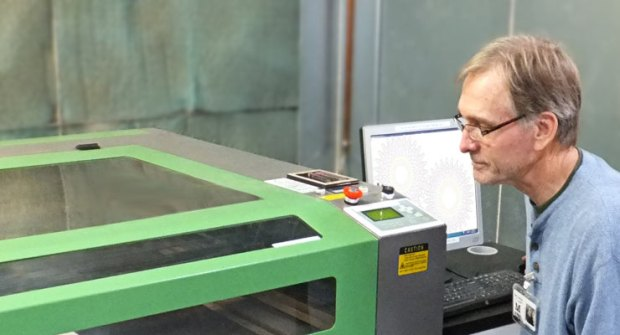 Dan using the 100 watt Hurricane Laser Cutter at MakerPlace in San Diego, CA