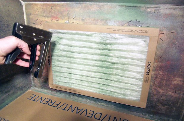 ...thenstaple a disposable furnace filter over the paper (it's wide enough to use twice  by repositioning sideways) When full of paint tear and and replace paper and filter.