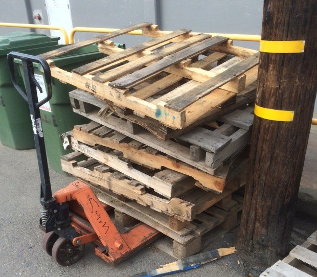 Stack of pallets behind grocery store