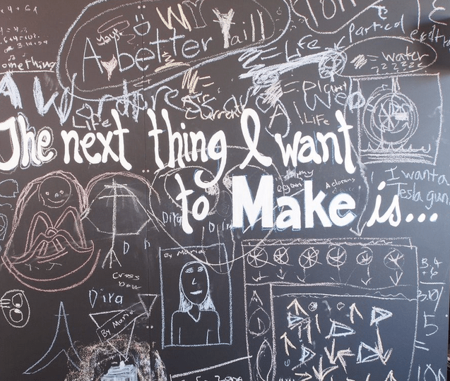 The Young Makers booth at Maker Faire Bay Area 2013, designed by Miranda Morgan and built by Kevin Rumon, included a chalkboard for generating ideas for after Maker Faire.